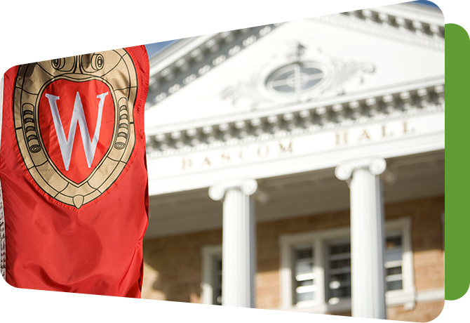 bascom hall with flag of university crest