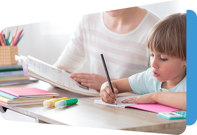 child writing in booklet with adult looking on