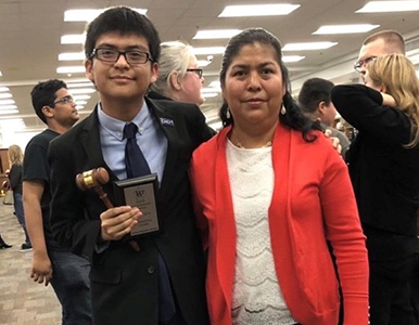 Daniel and his mom at a school event where he received an award from the debate team.