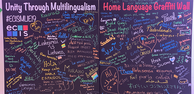 Black board with colorful words from many languages written on it