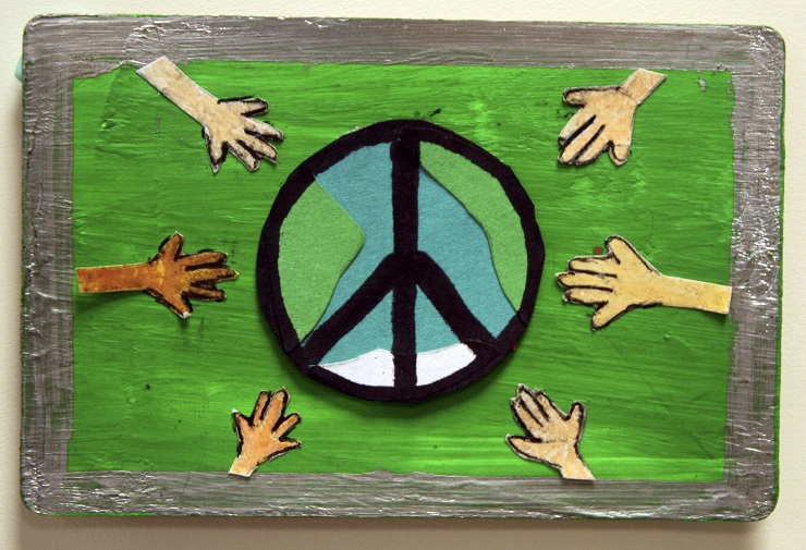 painting of hands reaching towards peace sign with green background
