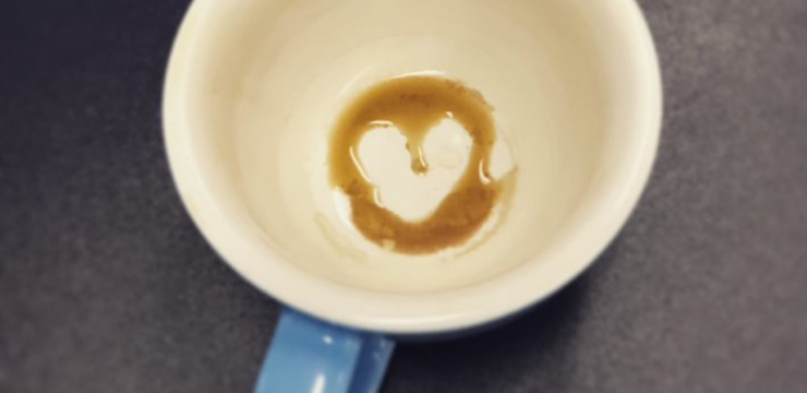 bottom of coffeecup with heart-shaped coffee dregs