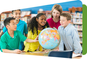 group of students around a globe