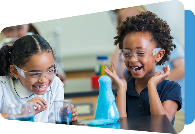 two younger students at science lab table